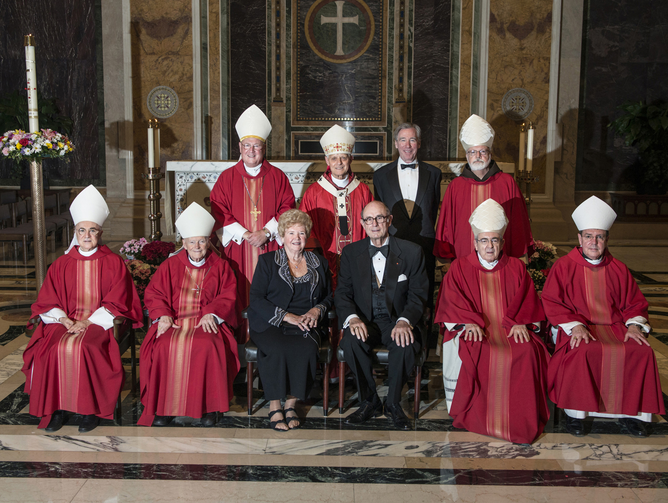 Archbishop Viganò seated next to then-Cardinal McCarrick, front row on left, along with other U.S. cardinals, Glory and Thomas Sullivan and John Garvey, at a fundraiser on May 10, 2013. (CNS photo/Edmund Pfueller, Catholic University of America)