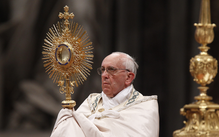 Pope Francis leads the Benediction following eucharistic adoration in St. Peter's Basilica at the Vatican June 2. Catholics gathered at the same time for eucharistic adoration in cathedrals and parishes around the world for the first Vatican-organized global holy hour. (CNS photo/Paul Haring)