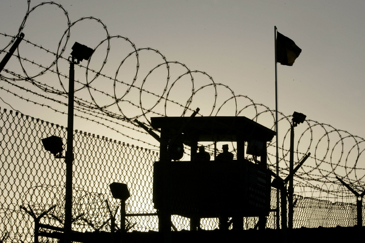 U.S. Army troops stand guard over Sally Port One at Camp Delta in 2006 where detainees are held at the U.S. Naval Base in Guantanamo Bay, Cuba. (CNS photo/Joe Skipper, Reuters)