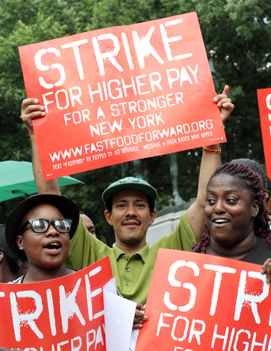 Fast-food workers and supporters demand higher wages during rally in New York. (CNS photo/Gregory A. Shemitz)