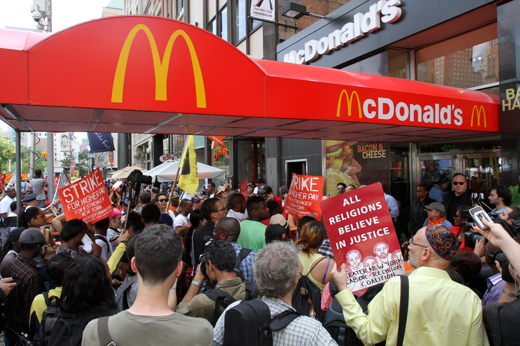 Fast-food workers and supporters demand higher wages during rally in New York (CNS photo/Gregory A. Shemitz)