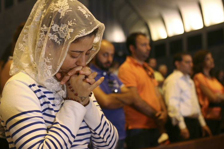 Lebanese and Syrian Christian Maronites pray for peace in Syria. (CNS photo/Hasan Shaaban, Reuters)