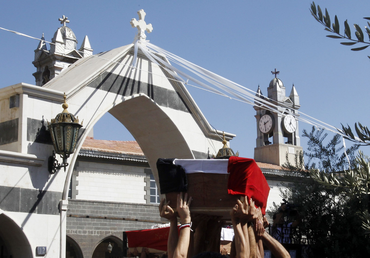 Mourners carry coffins of Christian men killed during raid in Syria (CNS photo/Khaled al-Hariri, Reuters)