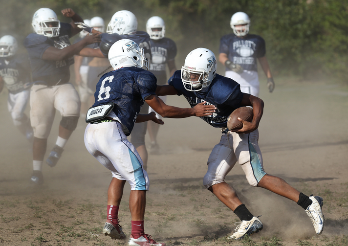 Player attempts to make tackle during football practice at Maryland Catholic high school. (CNS photo /Bob Roller)