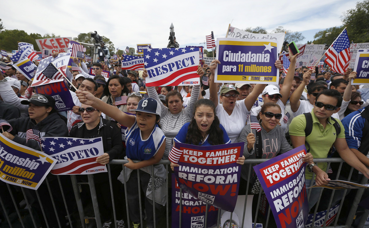 Hundreds of protesters calling for comprehensive immigration reform gather at a rally on the National Mall in Washington Oct. 8 (CNS photo/Jason Reed, Reuters)