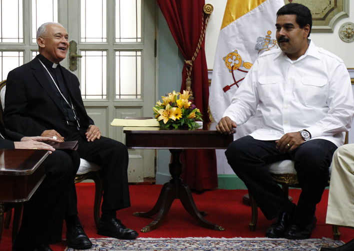 Venezuela's President Maduro talks with Archbishop Padron during meeting in Caracas.