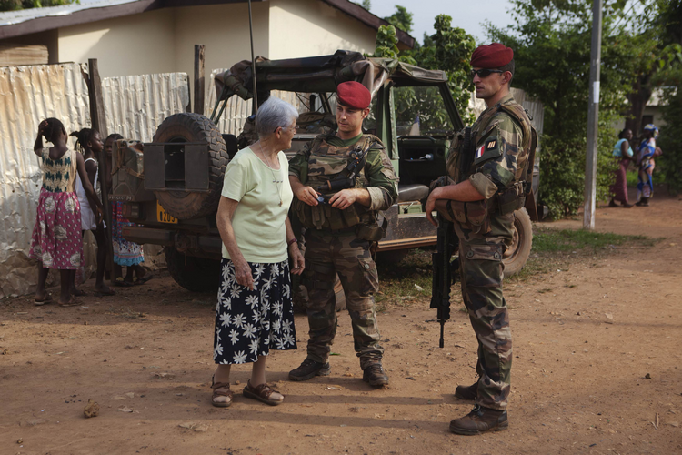 French soldier checks on safety of nun during patrol in Central African Republic. (CNS photo/Joe Penney, Reuters)