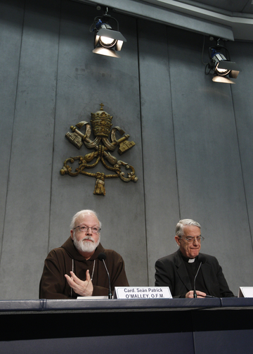 Boston Cardinal O'Malley and Jesuit Father Lombardi lead press conference at the Vatican (CNS photo/Paul Haring)
