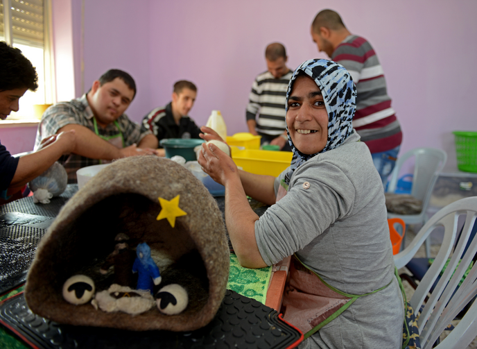 Palestinians with intellectual disabilities make felted wool ornaments, Nativity sets and other gift items from the wool of Bethlehem sheep at the Ma'an lil-Hayat in Bethlehem. (CNS photo/Debbie Hill)