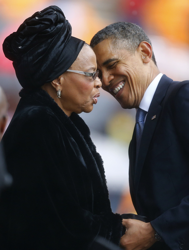 U.S. President Obama pays respects to Graca Machel at memorial service for her late husband, Nelson Mandela (CNS photo/Kai Pfaffenbach, Reuters)