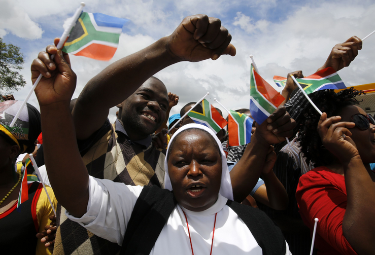 Nun marches with mourners before the arrival of body of former South African President Nelson Mandela in Mthatha.