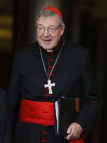 Cardinal Pell of Sydney leaves meeting of cardinals with Pope Francis in synod hall at Vatican. (CNS photo/Paul Haring)