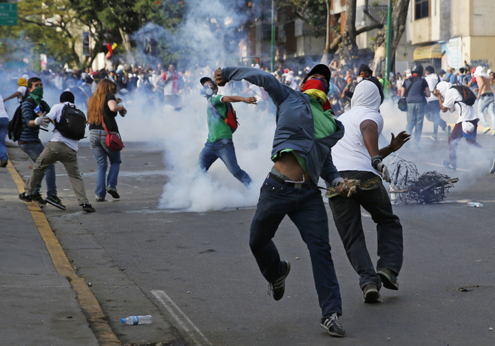 Demonstrators confront police during protests in Venezuela.