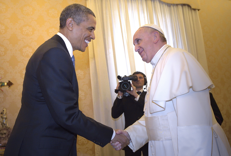 President Obama shakes hands with Pope Francis during private audience at Vatican. (CNS photo/Stefano Spaziani, pool)