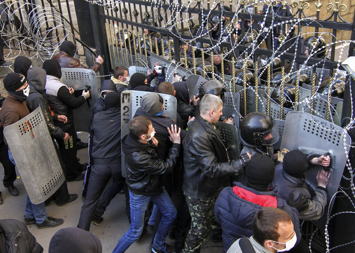 Pro-Russia protesters scuffle with the police at the regional government building in Donetsk.