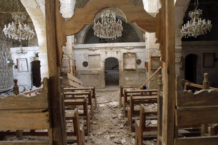Debris seen inside damaged church in Syria.