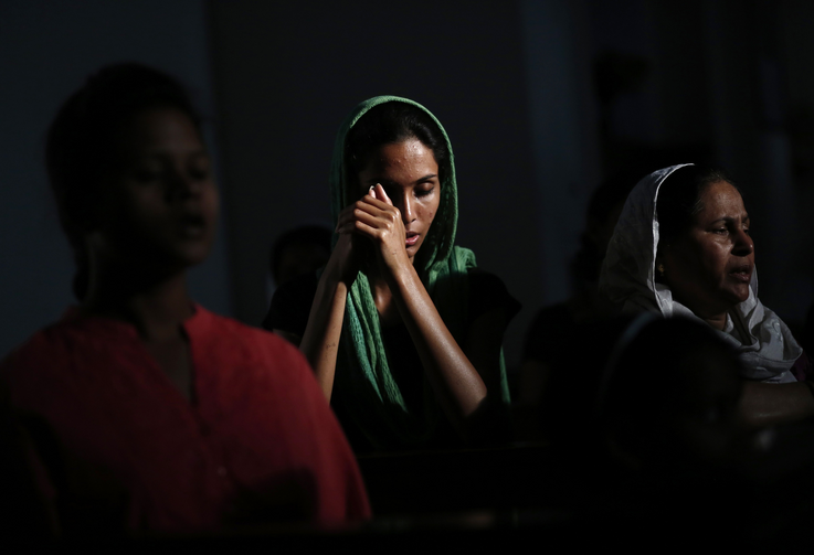 Catholic devotees pray during Good Friday liturgy in New Delhi. (CNS photo/ Anindito Mukherjee, Reuters)