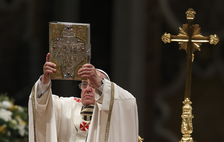 Pope Francis raises the Book of the Gospels as he celebrates the Easter Vigil in St. Peter's Basilica at the Vatican April 19. (CNS photo/Paul Haring)