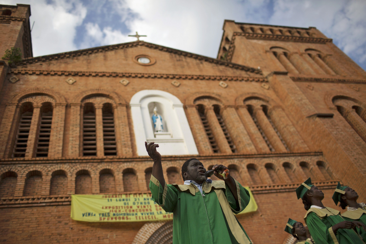 A member of a choir sings a song of reconciliation and peace in front of a Catholic cathedral during the last day of Easter celebrations in Bangui, Central African Republic, April 21. (CNS photo/Siegfried Modola, Reuters)