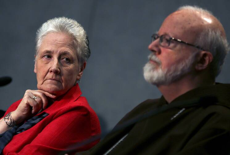 Irish abuse victim Marie Collins, the lone clerical abuse survivor nominated by Pope Francis to sit on the new Pontifical Commission for the Protection of Minors, looks at Boston Cardinal Sean P. O'Malley during their first briefing at the Holy See press office at the Vatican on May 3. (CNS photo/Alessandro Bianchi, Reuters)