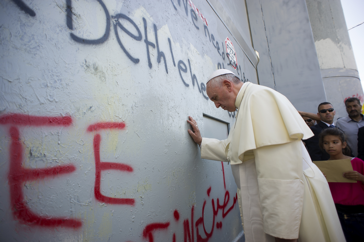 Pope Francis stops in front of the Israeli security wall in Bethlehem, West Bank. (CNS photo/L'Osservatore Romano, pool)