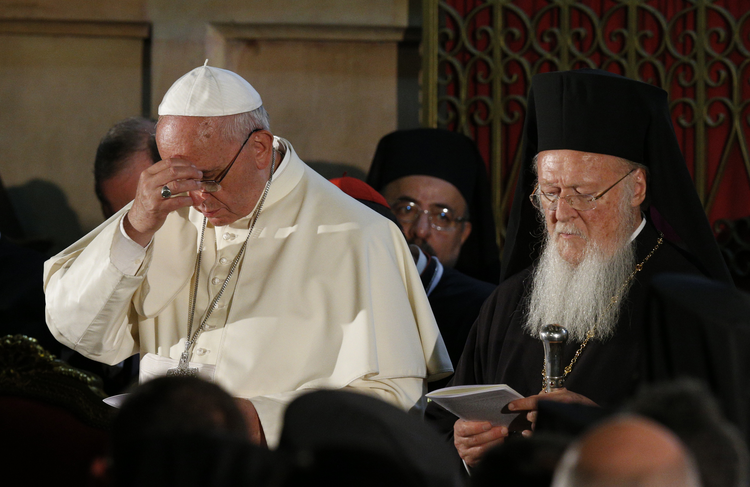 Pope Francis and Ecumenical Patriarch Bartholomew attend ecumenical celebration in Church of the Holy Sepulcher in Jerusalem. (CNS photo/Paul Haring)