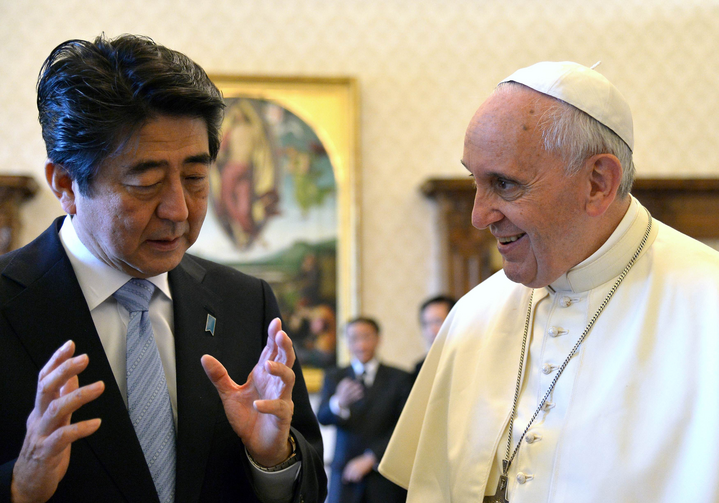 Japanese Prime Minister Shinzo Abe gestures as he speaks to Pope Francis while exchanging gifts during private audience at Vatican in June 2014.