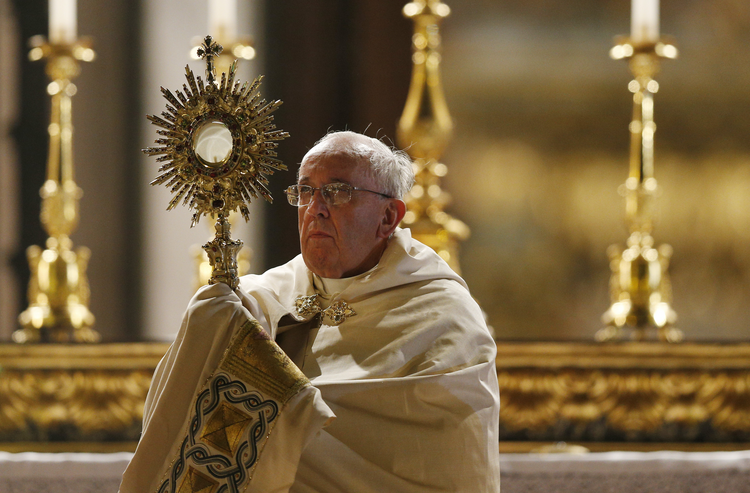 Pope Francis leads Benediction outside the Basilica of St. Mary Major as he celebrates the feast of Corpus Christi in Rome June 19. (CNS photo/Paul Haring) (June 20, 2014)