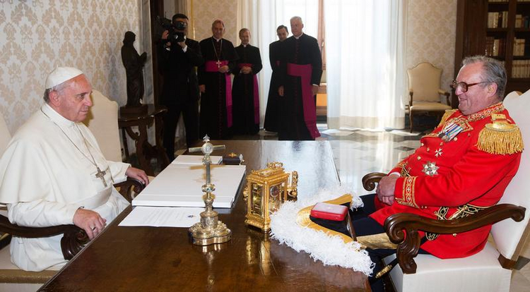 Pope Francis speaks with Fra' Matthew Festing, the 79th prince and grand master of the Sovereign Military Order of Malta, during a private audience at the Vatican June 20. (CNS photo/Claudio Peri, pool via Reuters) (June 23, 2014)