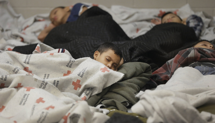 Detainees sleep in holding cell at U.S. Customs and Border Protection processing facility in Brownsville, Texas. (CNS photo/Eric Gay, pool via Reuters)