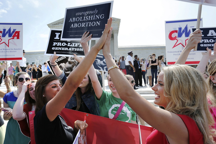 Pro-life demonstrators celebrate June 30 outside the U.S. Supreme Court in Washington as its decision in the Hobby Lobby case is announced. (CNS photo/ Jonathan Ernst, Reuters)