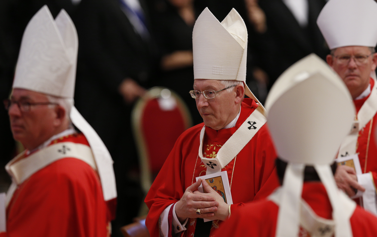 Archbishop Leonard P. Blair of Hartford, Conn., center, wears his new pallium as he leaves in procession at the conclusion of a Mass celebrated by Pope Francis to mark the feast of Sts. Peter and Paul in St. Peter's Basilica at the Vatican June 29.