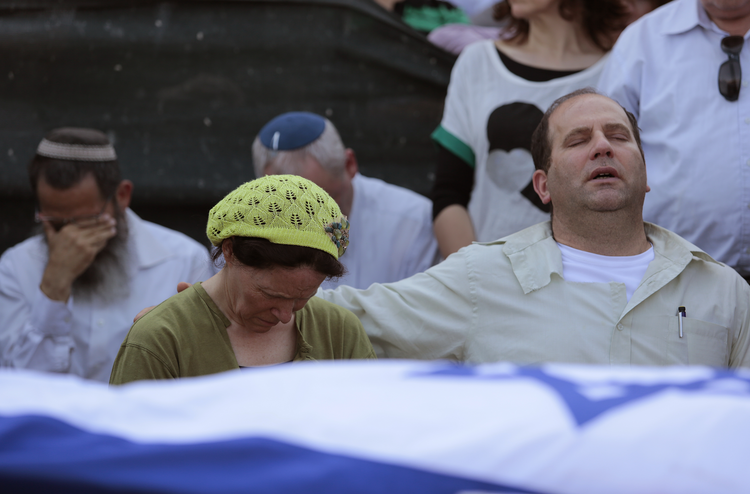 The parents of Naftali Frankel attend his funeral service in Nof Ayalon, Israel, July 1. (CNS photo/Jim Hollander, EPA)