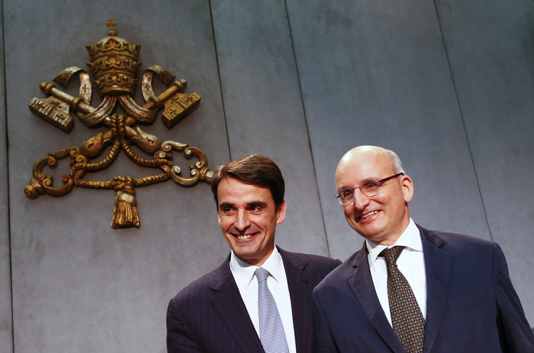 Jean-Baptise de Franssu, new president of Vatican bank, and outgoing president Ernst Von Freyberg pose during news conference. (CNS photo/Tony Gentile, Reuters)
