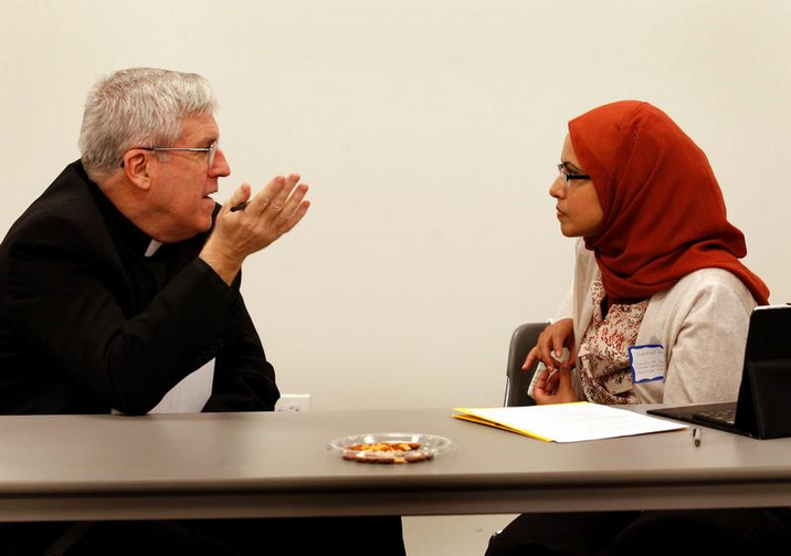 Oblate Father John Crossin is pictured talking with Humaira Basith of the Council of Islamic Organizations of Greater Chicago in this 2012 photo. (CNS photo/Karen Callaway, Catholic New World)