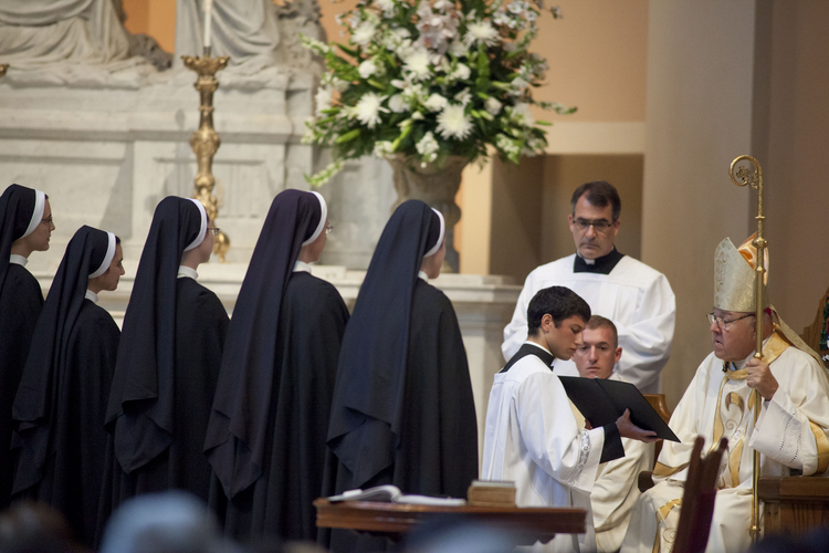 Five Dominican sisters face Nashville bishop during Mass where they made final profession of religious vows.