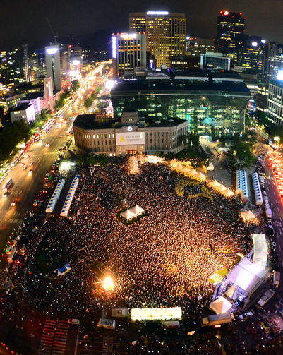 People gather at the Seoul Plaza in front of the City Hall in downtown Seoul July 24. Asian Youth Day will coincide with Pope Francis' visit to that country, where he is scheduled to beatify 124 Korean martyrs.