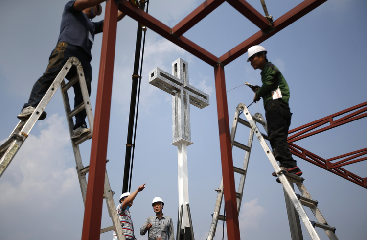 Laborers install cross in Seoul, South Korea, for Pope Francis' visit. (CNS photo/ Kim Hong-Ji, Reuters)