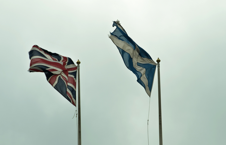 Scottish, British flags fly outside Scotland Office in London.