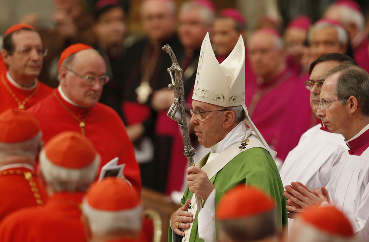 Pope Francis arrives to celebrate Mass in St. Peter's Basilica to open extraordinary Synod of Bishops on the family. (CNS photo/Paul Haring)