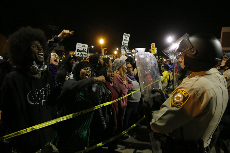 Protesters square off against police during a rally for Michael Brown outside the police department in Ferguson. (CNS photo/Jim Young, Reuters)