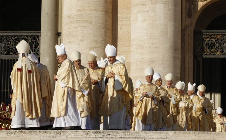Bishops arrive for the beatification Mass of Blessed Paul VI celebrated by Pope Francis in St. Peter's Square at the Vatican Oct. 19. The Mass also concluded the extraordinary Synod of Bishops on the family.(CNS photo/Paul Haring)