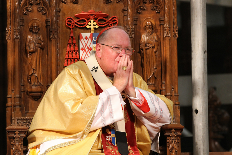 Cardinal Timothy M. Dolan of New York presides at an August Mass at St. Patrick's Cathedral in New York.  (CNS photo/Gregory A. Shemitz)