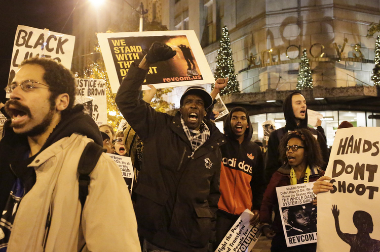 A Nov. 24 march in Seattle protested the lack of an indictment in the Michael Brown case. (CNS photo/Jason Redmond, Reuters)
