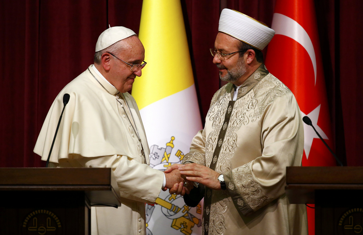 Pope Francis shakes hands with Mehmet Gormez, head of Turkey's religious affairs directorate, in Ankara Nov. 28. (CNS photo/Tony Gentile)
