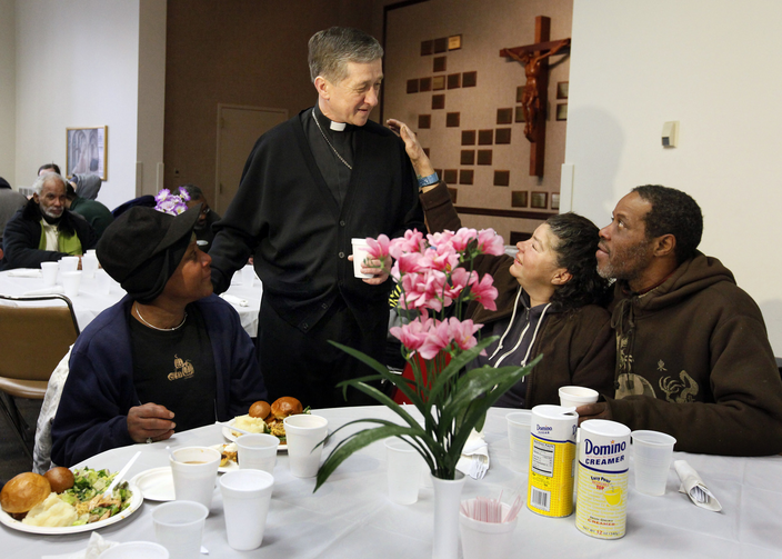 New Chicago archbishop greets guests during Thanksgiving dinner for homeless and hungry.