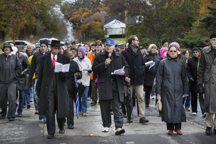 Parishioners from 10 churches in Ferguson, Mo., join in peace walk to City Hall.