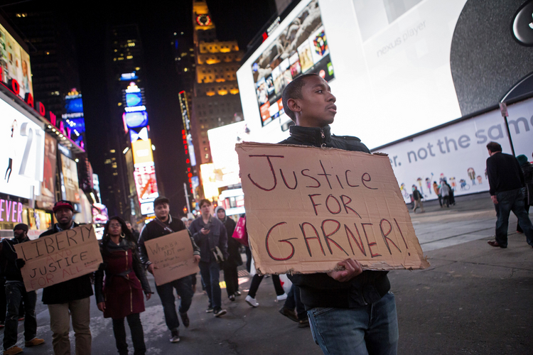 People protest death of Eric Garner in Manhattan borough of New York