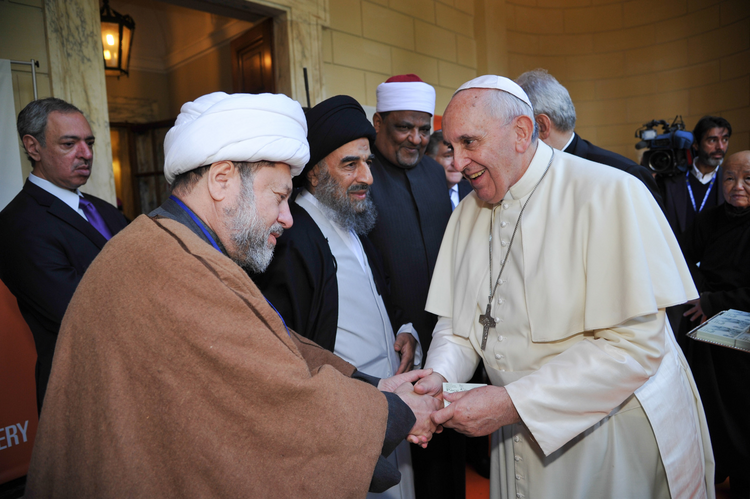 Pope Francis greets other faith leaders following a ceremony in observance of U.N. Day for the Abolition of Slavery.