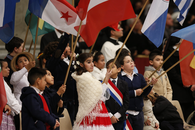 Children hold flags of American nations during Mass marking feast of Our Lady of Guadalupe in St. Peter's Basilica.